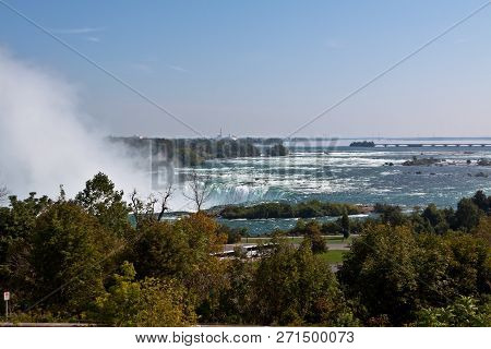 Horizontal From The Side Of The Horseshoe Falls With Landscape On A Sunny Day
