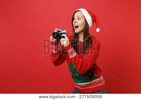 Surprised Young Santa Girl Taking Pictures On Retro Vintage Photo Camera, Keeping Mouth Wide Open Is