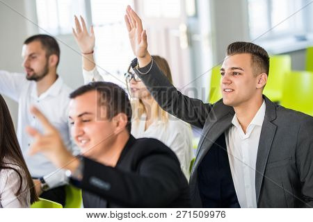 Confident Business People Raising Hands To Answer Questions Of Business Man Of Course