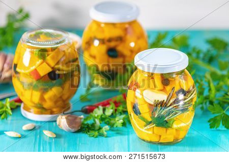 Marinated Preserving Jars. Homemade Orange Cut Pumpkin Pickles With Red Hot Chili Peppers, Fresh Par