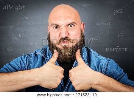 An Expressive Man With Thumbs Up On Grey
