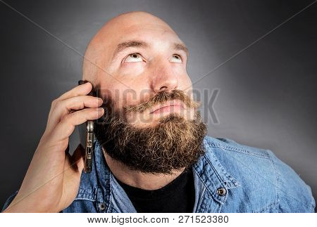 A Doubting Man Speaking On The Phone