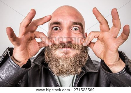 A Bearded Man Who Arranges His Mustache