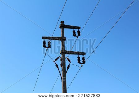 Electrical Power Line Utility Pole Made Of Strong Concrete With Multiple Ceramic Insulators Connecti