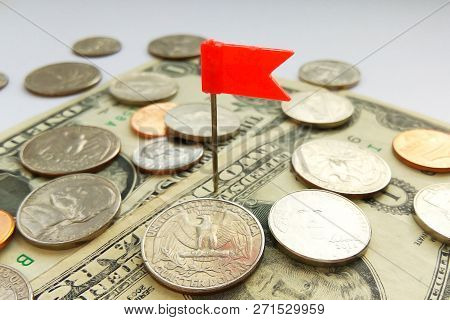 Close Up American Quarter, Dime And Penny Coins On Dollars Usa With Red Pin Flag Background
