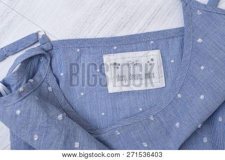 Kharkov, Ukraine- November 07, 2018: White Label F&f On Blue Clothes. Close Up. Fashion Concept