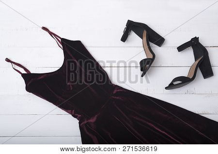 Velvet Burgundy Dress And Shoes On Wooden Background. Fashionable Concept