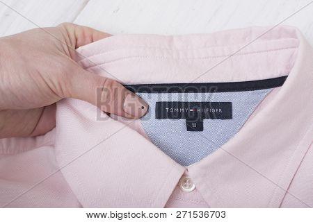 Kharkov, Ukraine- November 07, 2018: Collar Of Pink Shirt In Female Hand. Fashionable Concept