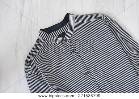 Shirt With Stripes On Wooden Background. Fashionable Concept