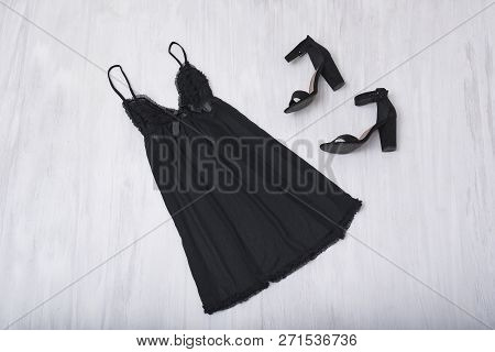 Black Nightie And Shoes On A Wooden Background. Fashion Concept