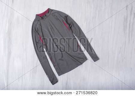 Gray Jacket For Sports On A Wooden Background. Fashion Concept