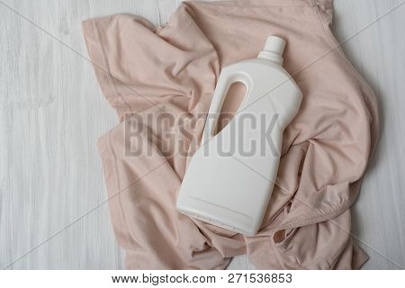 Clothes And Bottle With Detergent. Top View