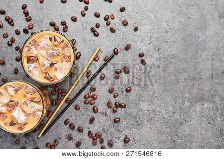 Cold Brewed Iced Coffee In Tall Glass With Coffee Beans And Straws On Grey Concrete Background. Choc
