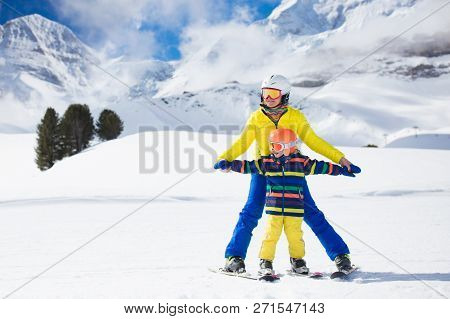 Little Girl And Boy Enjoy A Sleigh Ride. Child Sledding. Toddler Kid Riding A Sledge. Children Play
