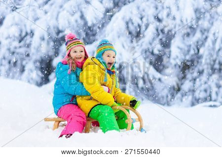 Kids Play In Snow. Winter Sled Ride For Children