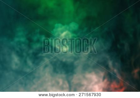 Soft Focus Abstract Image Of Colorful Smoke On Dark Background. Texture And Abstract Art