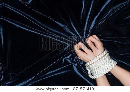Close Up Of Female Hands Tightly Bounded With Rope