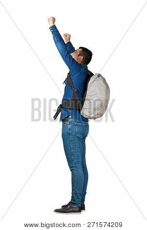 Side View Full Length Portrait Of Confident Young Man Carrying A Backpack Raising Hands Up Celebrate
