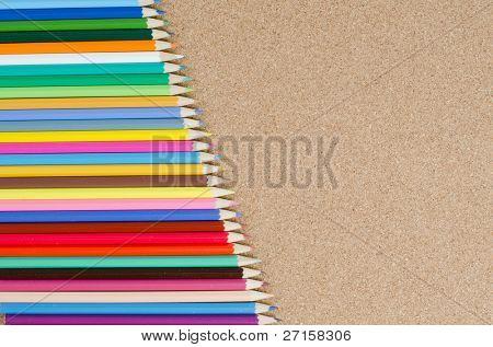 The colour pencils on ���orkboard. School concept