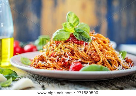 Fresh And Delicious Spagetti Bolognese On Wooden Table.