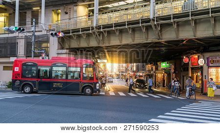 Tokyo, Japan - August 2018: Unrecognizable People Walking In The City, A Scene From Tokyo City Life