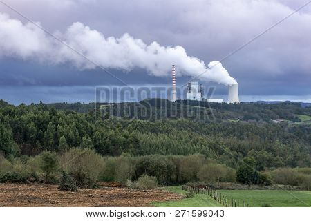 Environmental Pollution Problem Concept. Coal Power Plant Polluting The Planet. Thick Chimney Smokin