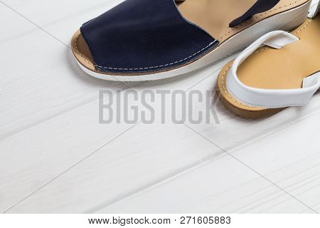 Summer White And Blue Sandals On White Woooden Background. Fashion Style, Minimalism Set. Top And Si