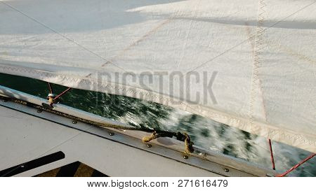 Bow Of A Sailing Yacht Closeup, Clew Sail And Anchor Winch With A Rope In Front