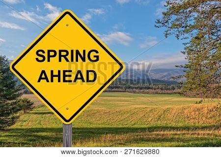 Spring Ahead Caution Sign With Springtime Background