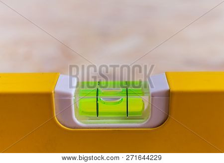 Close Up Photo Of A Leveling Tool Bubble Level Being Used