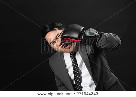 Asian Business Man In Suit And Boxing Gloves, Punch The Face By Himself, Express His Hurt Feeling On