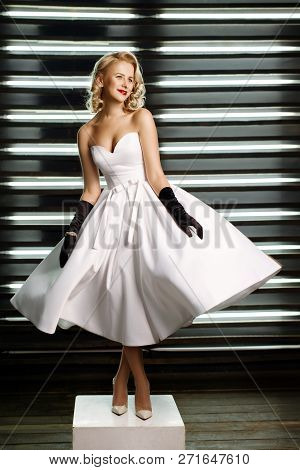 Pretty Young Girl Dressed At Pin-up Style