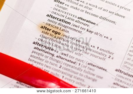 The Word Or Phrase Alter Ego In A Dictionary Highlighted With Marker.
