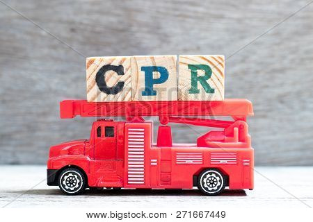 Toy Fire Ladder Truck Hold Letter Block In Word Cpr (abbreviation Of Cardiopulmonary Resuscitation)