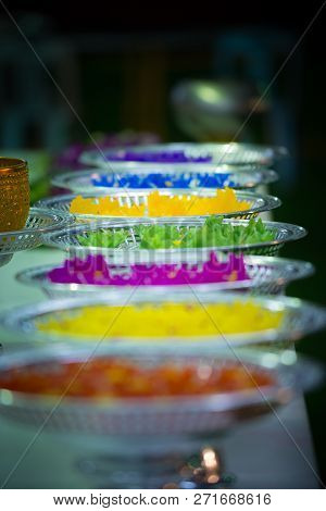 Platters With Colorful Lotos Floating Flower Candles Vertical Composition Thailand