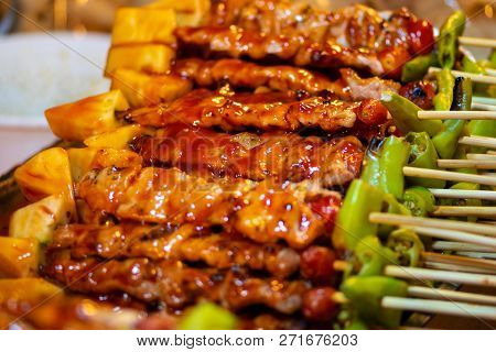 Barbecue Chicken Skewers In Red Sauce, Thai Street Food Background