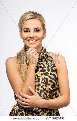 Lady In Brown Gown Posing In Studio. Beautiful Elegant Woman, Long Blond Hair In Evening Dress. Beau