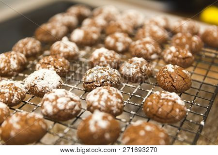 Baked Chocolate Cookies With Powdered Sugar Cooling On A Rack.