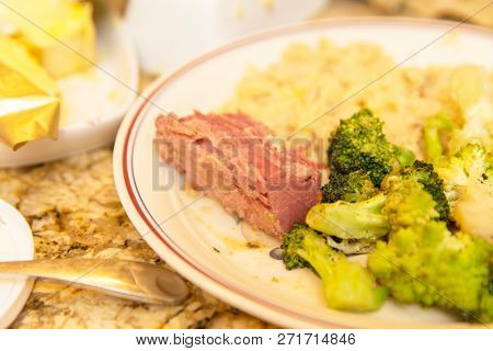 Ceramic Plate With Corned Beef, Broccoli, And Rice In A Kitchen Setting.