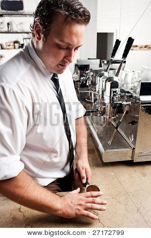 Barista prepares his coffee for the espresso machine