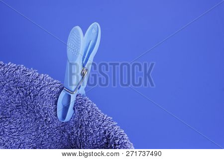 Blue Peg On Blue Towel On Blue Background