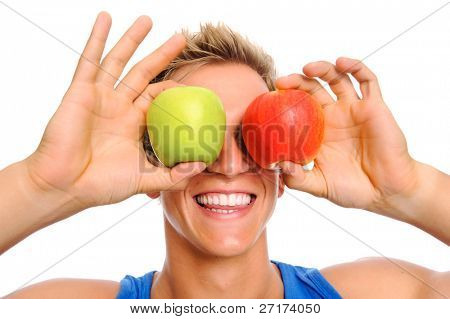 Fit and healthy lifestyle concept with a green and red apple representing a man's eyes