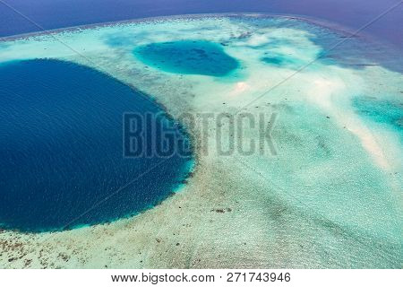 Aerial View On Maldives Island, Ari Atoll. Tropical Islands And Atolls In Maldives From Aerial View.