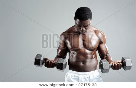 Well built muscular black man pumping iron