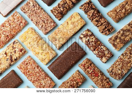 Flat Lay Composition With Protein Bars On Color Background