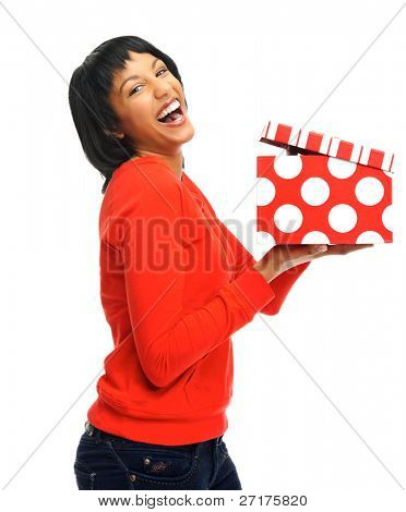 Woman is surprised to receive a present, she opens the box