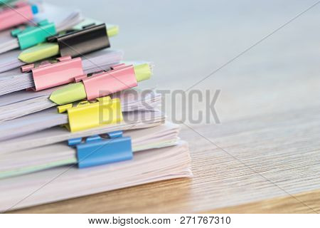 Close Up Pile Of Unfinished Homework Assignment Stacked In Archive With Colorful Binder Paper Clips