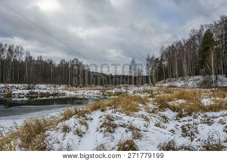 The First White Snow Fell On The Yellow Grass On The River Bank.