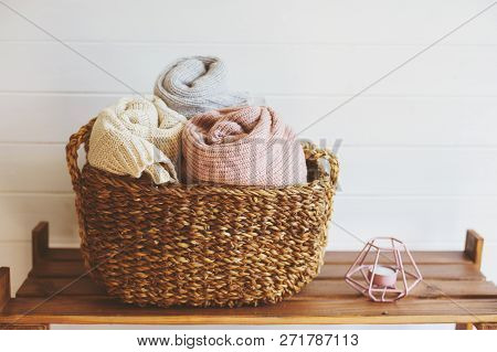 Cozy Interior Details, Scandinavian Mininalistic Lifestyle. Organizing Clothes In Wicker Backets, Se