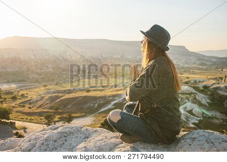 A Girl Practices Yoga Or Meditation Or Searching For A Soul. Solitude And Unplugged
